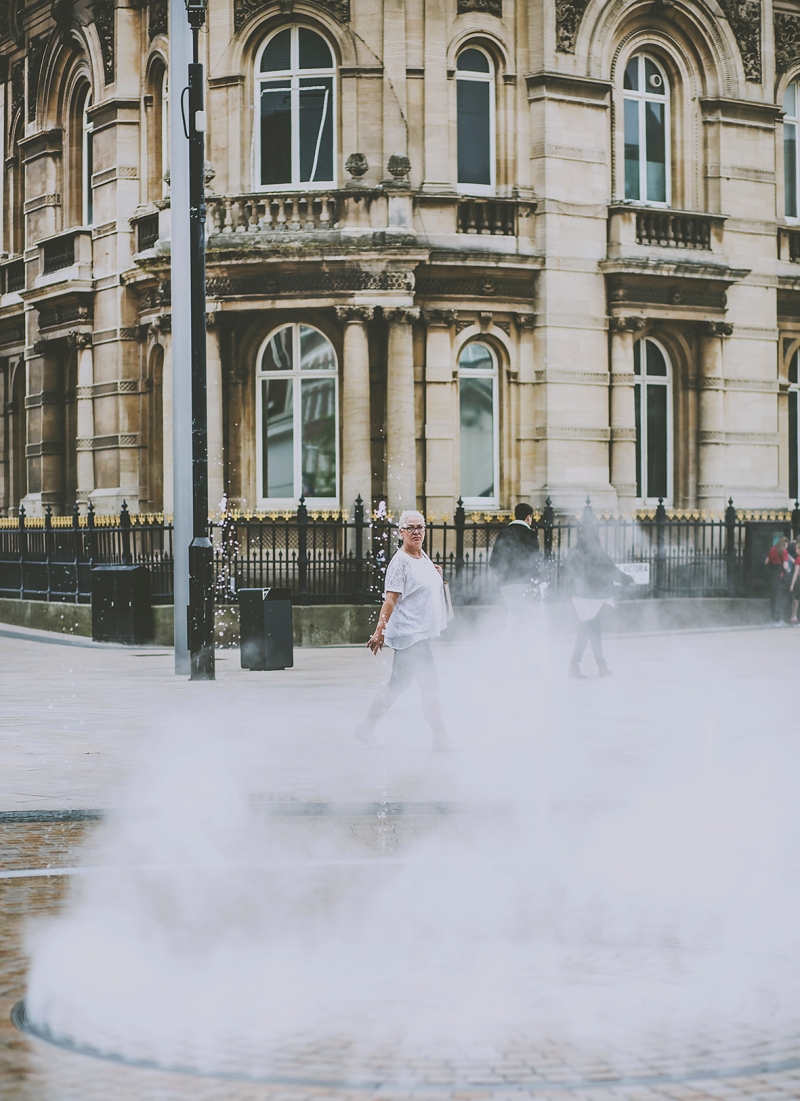 Hull Queen Victoria Square Fountains Steam Women walking past